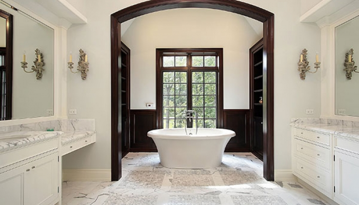 Large marble based bath tub, vanities and cabinets with wooden frames.