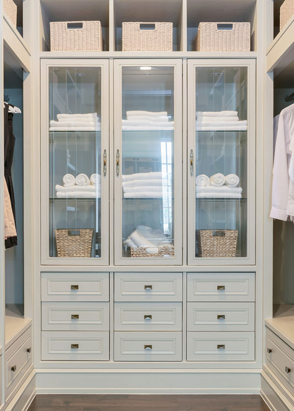Pale grey walk in closet